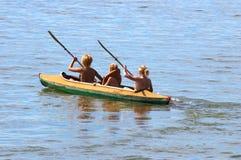 Kayak and girls. Kayak and three girls Royalty Free Stock Images