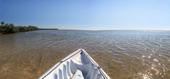 Kayak glides through water along the coastline of Marco Island, royalty free stock photo