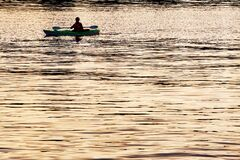 Kayak On Golden River Royalty Free Stock Image
