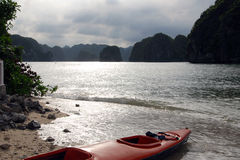 Kayak in ha long bay. A red kayak on the beach in ha long bay, vietnam royalty free stock photography