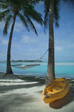 Kayak and Hammock on a Tropical Beach. Empty kayak and hammock on a tropical beach in Aitutaki, Cook Islands Royalty Free Stock Photo