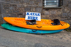 Kayak Hire. Two Kayaks for hire, one yellow: one blue stock images