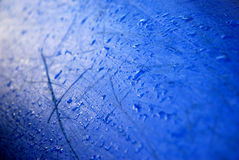 Kayak hull with water droplets. The hull of a blue kayak with water droplets Stock Photography
