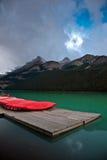Kayak II. Several kayak on a pier, prepared for hikers Stock Image