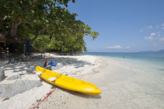 Kayak on an isolated island beach Royalty Free Stock Images