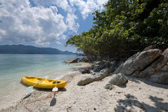 Kayak on an isolated island beach Stock Photos