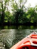 Kayak. Ing summer green trees Michigan Royalty Free Stock Photo