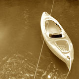 Kayak on lake. Elevated sepia view of kayak on lake or river Stock Image