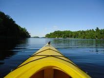 Kayak on the Lake. Kayaking into the crisp waters of Charleston Lake Stock Photos