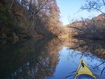 Kayak on the lake. Morning kayak ride on the morning waters Royalty Free Stock Photo