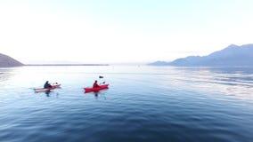 Kayak on Lake Skadar in Montenegro. Tourist kayaking. Aerial Pho. To drone stock video footage