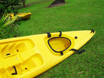 Kayak on the lawn near the river Royalty Free Stock Photos