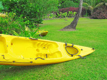 Kayak on the lawn near the river Royalty Free Stock Photography