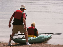 Kayak man helper Royalty Free Stock Photo