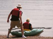 Kayak man helper. Kayak man helping his wife on Labrador coastline, Newfoundland, Canada Royalty Free Stock Photo
