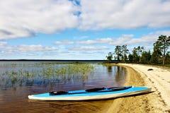 Kayak near the coast Stock Photos