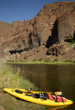 A kayak with nobody on a river in Oregon with mountains Stock Images