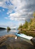Kayak on Northern Lake at Dusk Royalty Free Stock Photos