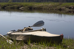 Kayak and oar. On coast of the river during a halt for a dinner Stock Images