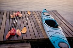 Kayak and oars are dried on the pier.  royalty free stock image