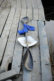 Kayak paddle. With a blue cloth grip on a wooden pier Royalty Free Stock Photography