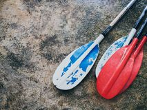 Kayak paddles on wet cement background stock images