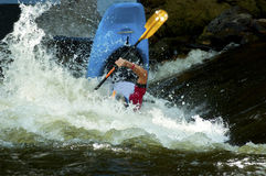 Kayak in paddling competition. Royalty Free Stock Images