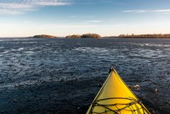 Kayak paddling in icy water Royalty Free Stock Photography