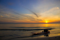 Kayak park by the sea at sunrise. Royalty Free Stock Photography