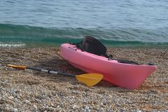 Kayak on a pebble beach Royalty Free Stock Photos