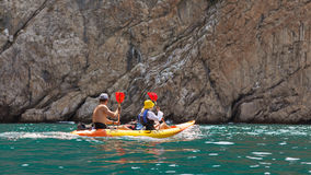Kayak. People kayaking in the ocean Royalty Free Stock Images