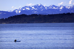 Kayak Puget Sound Olympic Mountains Washington stock photo