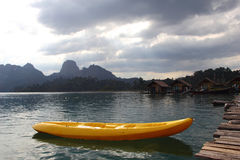 Kayak on Quiet Lake and cloudscape at Khao Sok Royalty Free Stock Photos
