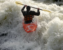 Kayak on the Rapids. Man paddling his Kayak on White Water Rapids Royalty Free Stock Image