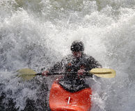 Kayak on the Rapids. Man paddling his Kayak on White Water Rapids Royalty Free Stock Photography