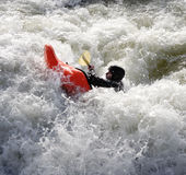 Kayak on the Rapids. Man paddling his Kayak on White Water Rapids Stock Photo