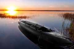 Kayak in the rays of the sun. Symbol: waiting for adventure. Russia. Pleshcheyevo lake stock images
