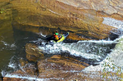 Kayak ready to Go Over Rapids Stock Photo