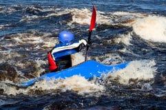 Kayak on river. Kayaker sporting a kayak cuts through water Royalty Free Stock Photo
