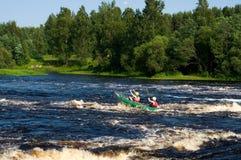 Kayak on river. Kayaker sporting a kayak cuts through water Royalty Free Stock Photography