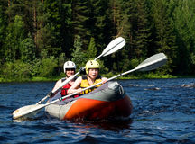 Kayak on river. Kayakers sporting a kayak cuts through water Royalty Free Stock Photo