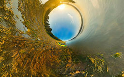 Kayak on river coast. Stereographic panorama, little planet Royalty Free Stock Photography