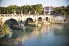 Kayak and River. A man in a Kayak paddling through the Tiber River and below the Ponte Sant'Angelo, Rome, Italy Stock Photos