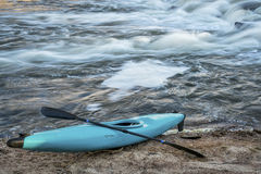 Kayak on river shore Royalty Free Stock Images