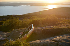 Kayak on a rock near the ocean during sunrise Stock Photo