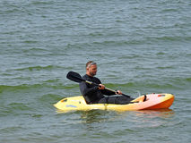 Kayak rowing man. Photo of a man rowing a kayak during summer holiday on the kent coast of whitstable taken 11th august 2017 Royalty Free Stock Photos