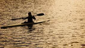 Kayak rowing men silhouette. Hight Definition Video : 23.97 FPS 20sec Please look another footages with professional demo Exercises on my Train_Arrival Account stock footage
