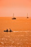 Kayak and sailboats royalty free stock photography