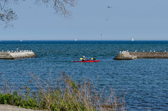 Kayak and sailboats on a lake Royalty Free Stock Images