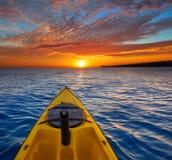 Kayak sailing in ocean sea at sunset stock photos
